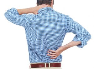 man holding his neck & lower back