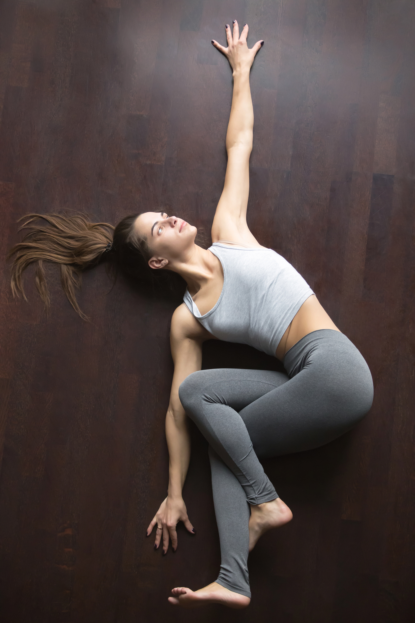 woman in Belly Twist Pose