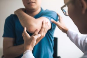 Physical therapist checking a patients elbow