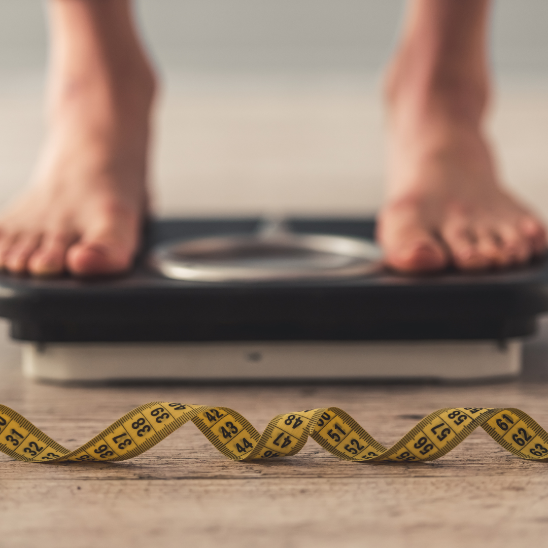 person on scale weighing themself