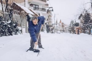 man with snow shovel, winter weather 3